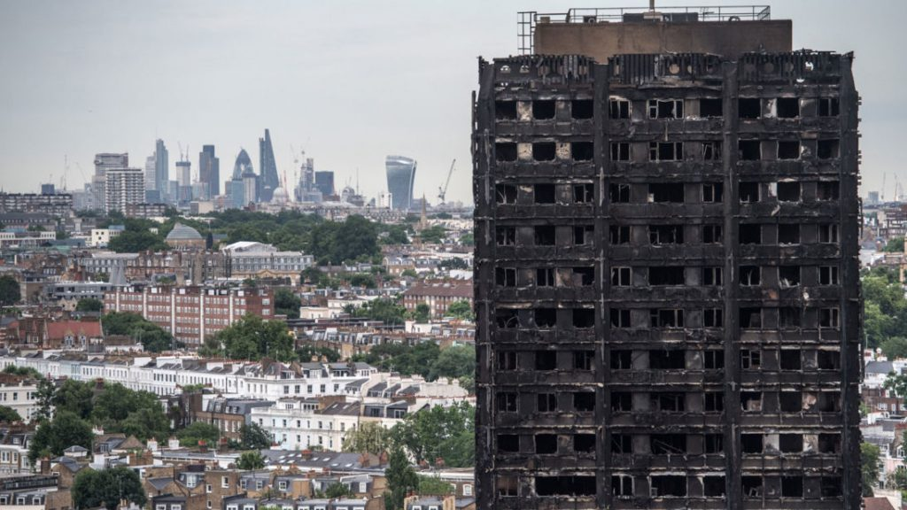 LONDON%2C+ENGLAND+-+JUNE+26%3A++The+City+of+London+skyline+is+seen+behind+the+remains+of+Grenfell+Tower+on+June+26%2C+2017+in+London%2C+England.+79+people+have+been+confirmed+dead+and+dozens+still+missing+after+the+24+storey+residential+Grenfell+Tower+block+was+engulfed+in+flames+in+the+early+hours+of+June+14%2C+2017.