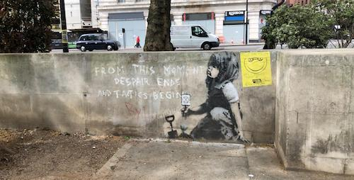 "Extinction Rebellion placed their logo next to graffiti of a child digging with the words ""From this moment despair ends and tactics begin."""
