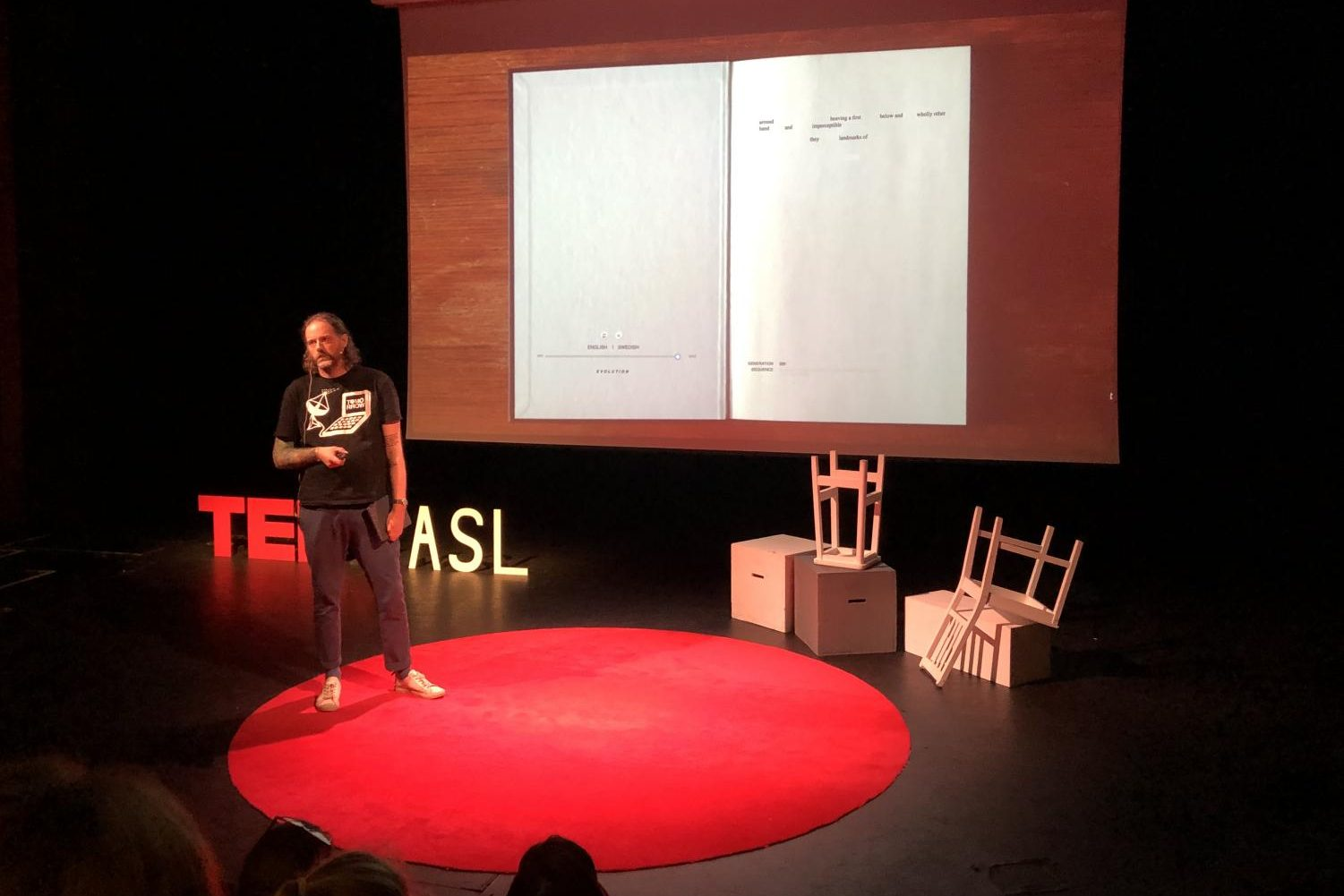 Johannes Helberg was the seventh speaker of event. He describes his constantly adapted poem where AI constantly adapts his poem to try and write using his voice.