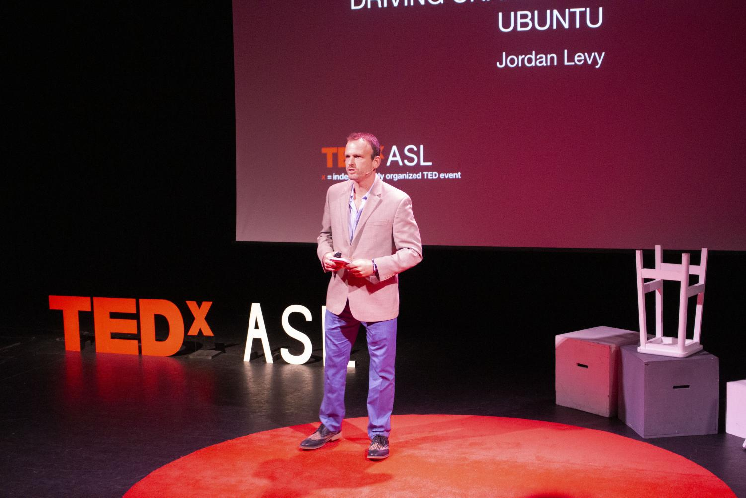Jordan Levy speaks to the high school during the TEDxASL conference. He spoke about his experience with Ubuntu Pathways, a nonprofit organization who helps impoverished communities in South Africa.