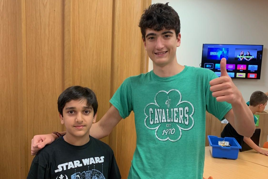 Ethan Otero ('21) works with a middle school students during the lego robotics (First Lego League) after school program. Otero recently moved back to ASL after living in Singapore for two years.
