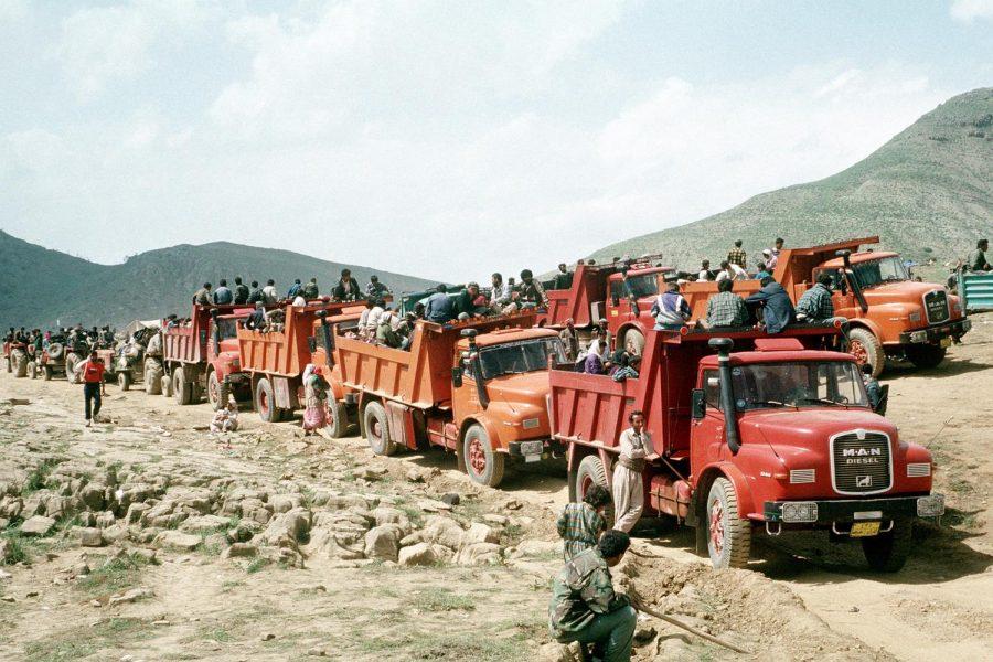 Kurdish refugees travel to U.S. military encampments.