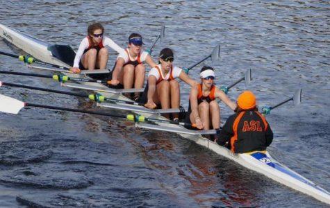 Crew team rows at Head of the Charles Regatta