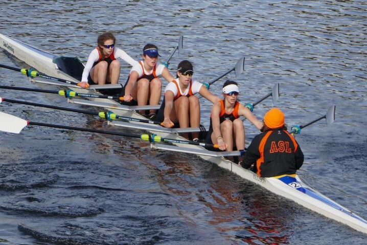 Crew team rows at Head of the Charles Regatta