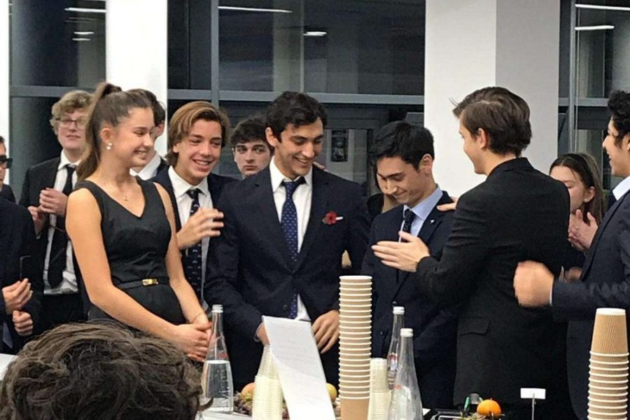 Debate+Team+Presidents+Liam+Hamama+%28%E2%80%9820%29+and+Max+Praiser+%28%E2%80%9820%29+celebrate+after+receiving+the+winning+vote+in+the+final+match.+The+team+of+Hamama+and+Praiser+didn%E2%80%99t+lose+any+of+their+debates%2C+and+competed+in+a+final+that+was+spectated+by+all+of+the+tournament+competitors.+The+debate+team+will+now+debrief+the+tournament+and+continue+to+prepare+for+future+competitions.+