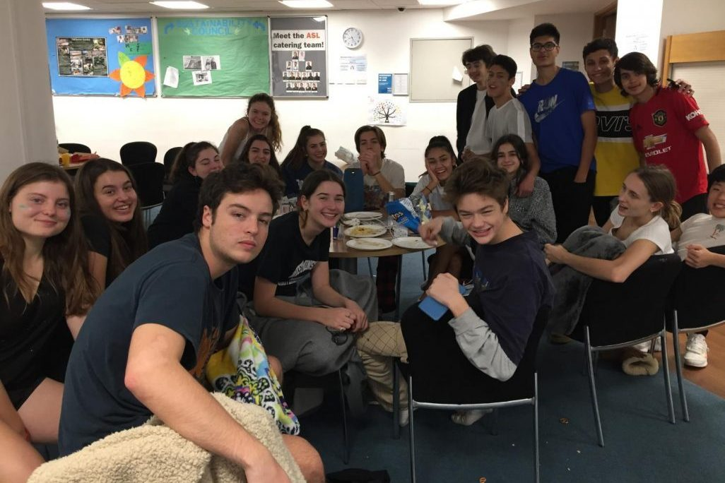Grade 11 students bond in the Theater Foyer during the night of the Lock In. Aside from pre-organized activities, Grade 11 students had a substantial amount of downtime throughout the event.
