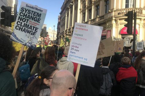 "Protestors march along Shaftesbury Avenue on their way to Trafalgar Square on Friday, Nov. 22. Many of the protesters held posters with sayings such as ""System Change not Climate Change"" and ""Planet not Profit."""