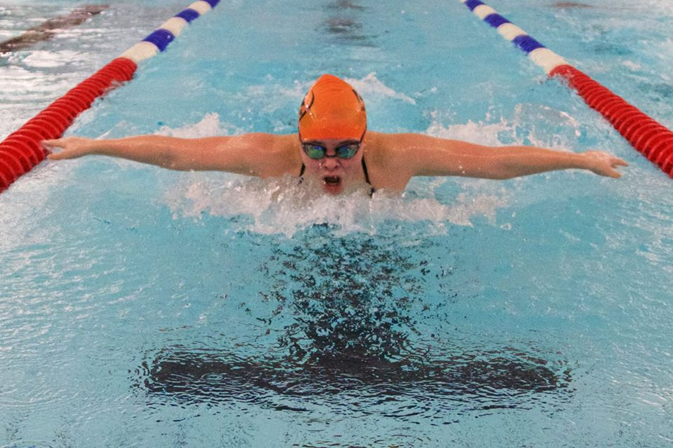 Anna Podurgiel ('20) competes in the 100m Butterfly in the swim meet against ACS Cobham Mar. 1, 2017.