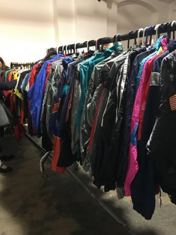 Another rack at the Vintage Kilo Sale with bomber jackets in vibrant colors.