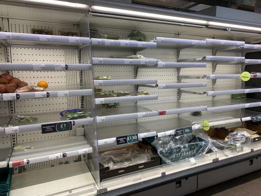 The aisles at the M&S in Earl's Court are barren because of panic-buying . Some stores are adding item limits to combat the issue.