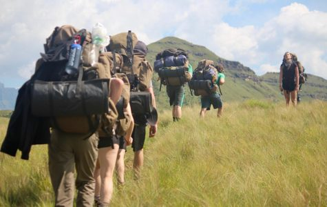 Students on last year's ecology trip hike in Hluhluwe-Imfolozi Park South Africa. This year's trip was canceled due to coronavirus concerns.