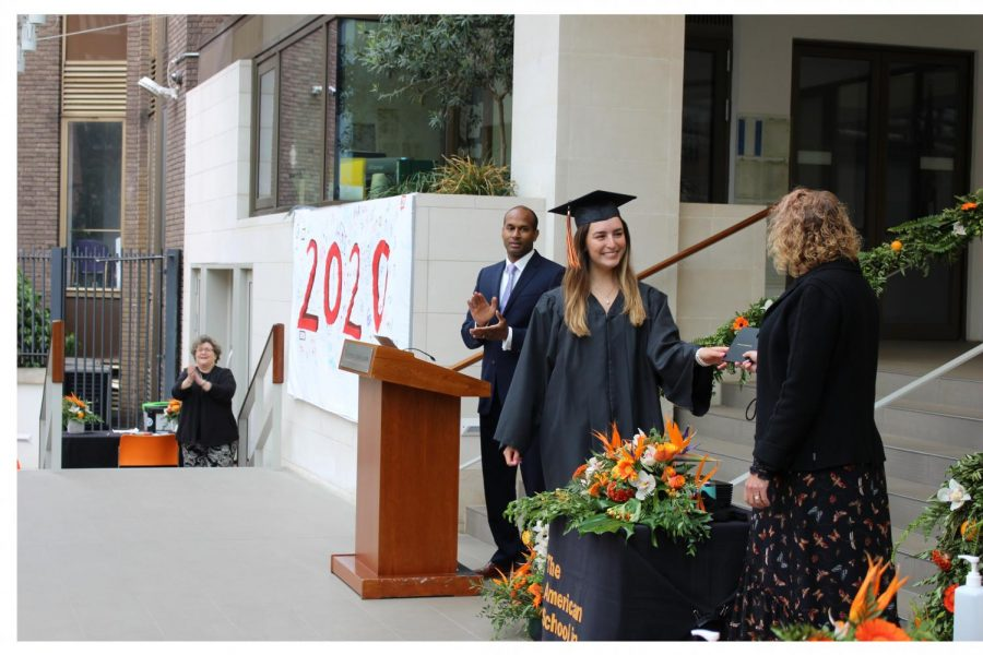 Sofia+Van+MIerlo+%28%2720%29+accepts+her+diploma+from+Head+of+School+Robin+Appleby.+Every+Grade+12+student+had+an+allotted+10+minutes+to+receive+their+diplomas+on+campus+from+Jun+3+to+5.