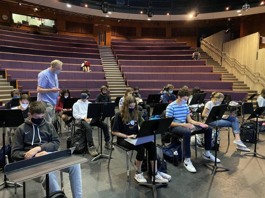 Due to not being able to play instruments, students in band class are learning to use technology to compose music, and at the same time, are following safety precautions such as wearing masks and socially distancing.