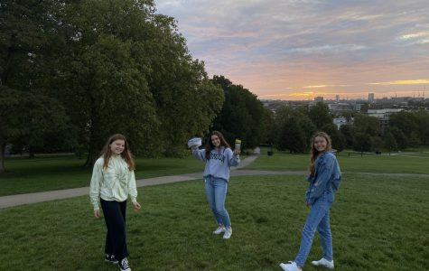 Solenne Jackson ('21), Mona Marouf ('21) and Eleanor Benton ('21) pose two meters apart in front of the sunrise. Grade 12 students gathered at the top of Primrose Hill at 5:45 a.m. to watch the sunrise.