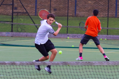 Jake Fellows ('21) gets ready to return a shot in a varsity tennis match against Highgate in May 2019. Fellows committed to Georgetown University for tennis Aug. 17.