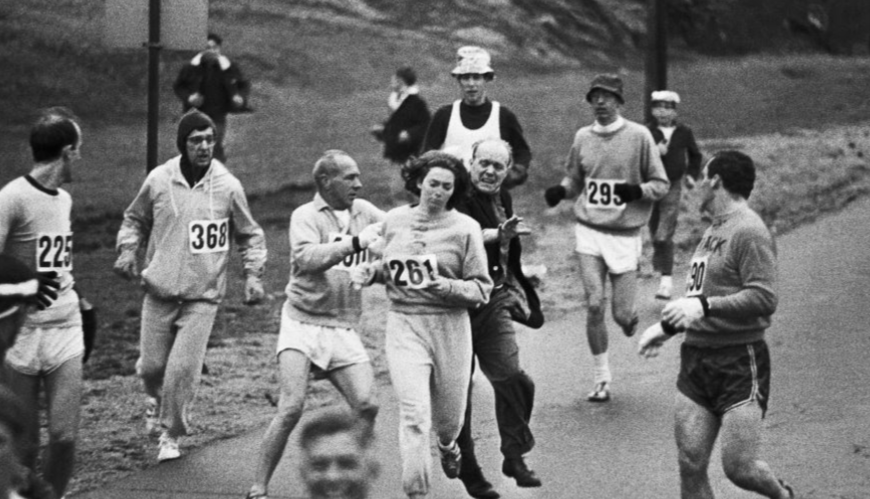 Race officials attempting to stop Kathrine Switzer from running the Boston Marathon. Switzer became the first registered woman to ever officially run the marathon, encouraging a change in athletics legislation calling for more gender equality in marathons.