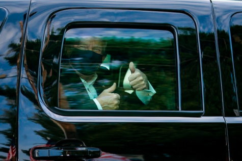 President Donald Trump greets supporters while driving outside the Walter Reed National Military Medical Center in Bethesda, Maryland. Trump was transferred to the hospital Oct. 2 after testing positive for COVID-19.