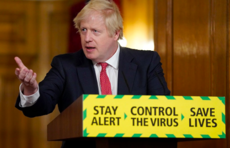 U.K. Prime Minister Boris Johnson gives a briefing on the U.K.'s COVID-19 outbreak. The government introduced a new plan to quell the spread of the virus based on local risk levels Oct. 12.