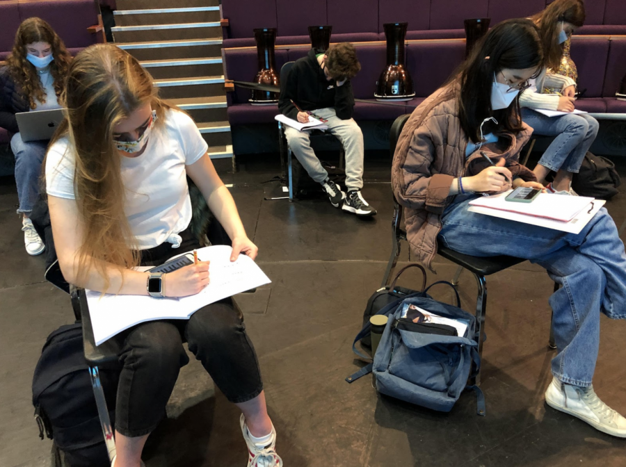 Brooke Beesley ('22) and Amber Auh ('21) compose a melody in Choir class. Until further notice, students are prohibited from singing despite U.K. government guidelines allowing them to do so.