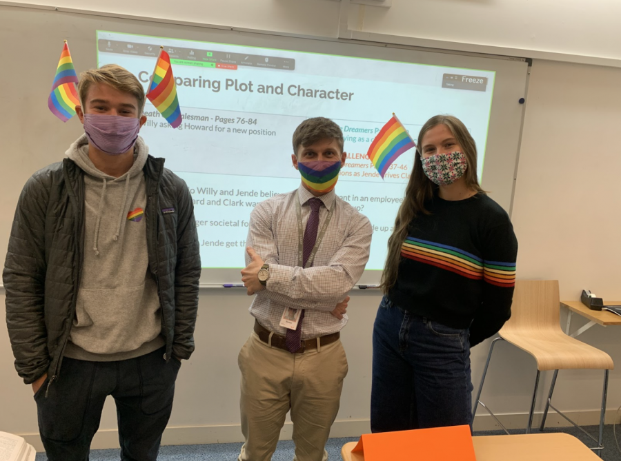 Owen Humphries ('22), English Teacher Sean Linton and Cece Muecke ('21) join the Gender-Sexuality Alliance's silent protest, wearing rainbow colors to show support for the LGBTQIA+ community. After middle school students hung up a Trump-Pence campaign flag Oct. 19, GSA encouraged students to show up to school Oct. 26 wearing rainbows on masks, flags and stickers.