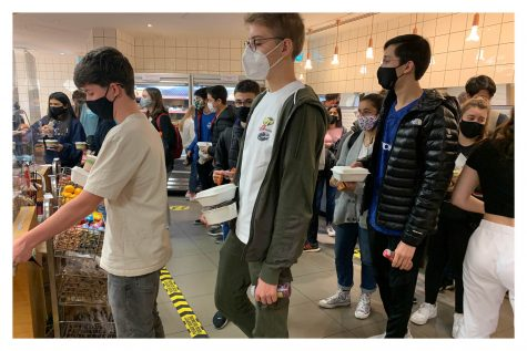 Owen Steege ('22), Aren Turhan ('22) and William Iorio ('22) queue to pay for their lunches in the cafeteria Nov. 9. Grades 10, 11 and 12 ate lunch on campus as the administration modified the open campus policy to permit just one grade level to leave campus each day.