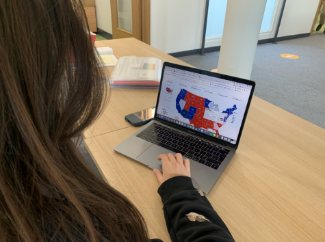 Sofia Michaelides ('22) checks the electoral map to see the state of the presidential race. The map is usually filled once students get to school, but results have been filtering in all day long and will continue into the coming days.