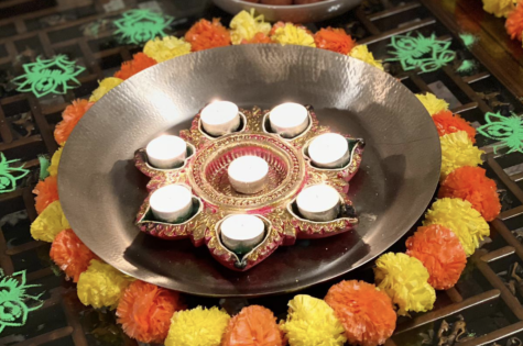 Rohit Venuturupalli ('21) celebrates Diwali Nov. 14 by lighting candles. Members of the South Asian community observed Diwali over five days and participated in the traditions it entailed.