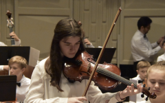Danielle Hajjar ('23) plays her viola in the AMIS Orchestra in 2019. She played a solo jazz piece in Russia during the festival.