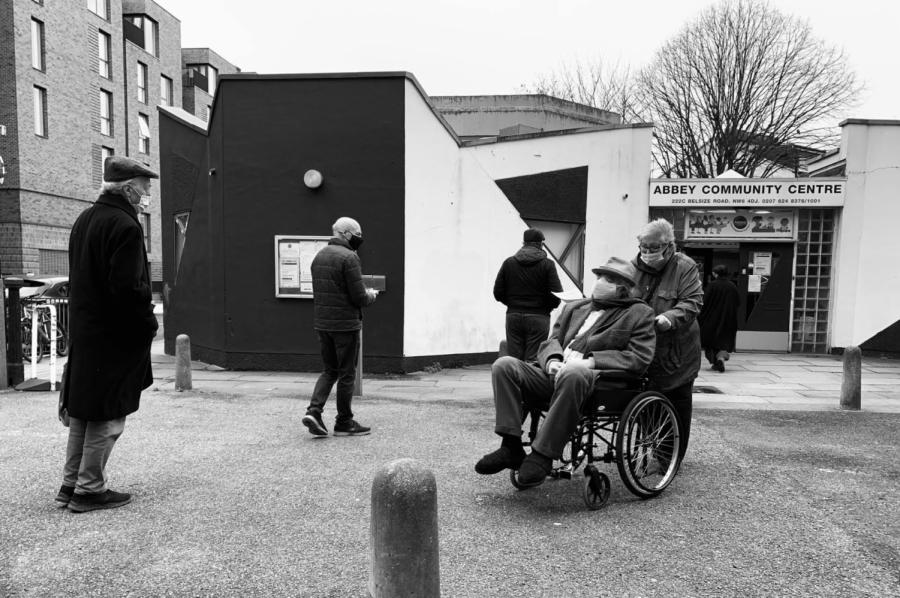 Members of the public queue outside the Abbey Community Centre in Kilburn to receive the COVID-19 vaccine Jan. 21. The first phase of the vaccine rollout, taking place now, is composed of nine priority groups which include all of those over 50 years old, those with pre-existing conditions and frontline health and social care workers.