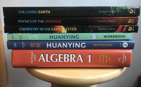 Grade 9 students receive new textbooks that contribute to their high school workload. Many of these textbooks, which were scarcely used in middle school, are new additions for Grade 9 students.