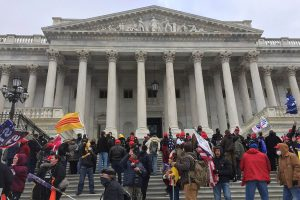 Pro-Trump rioters assemble outside the U.S. Capitol Jan. 6 to protest the certification of Biden's win after false accusations of a fraudulent election conspired. Four civilians and a Capitol police officer were killed when the protest turned violent.
