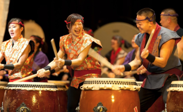 Chinese Teacher Ting-Chi Li (center) performs on the traditional Japanese percussion instrument, the Taiko. Li has been playing for around 20 years.