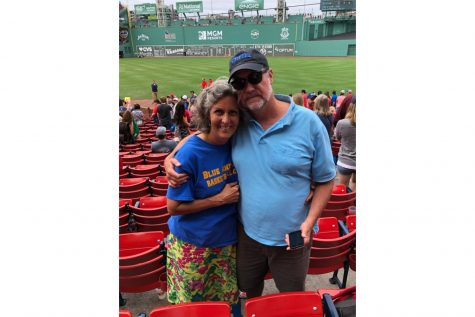 Jennifer Craig and her husband attend a Red Sox baseball game in the U.S. Many members of the community are avid sports fans who attend matches or watch them online.