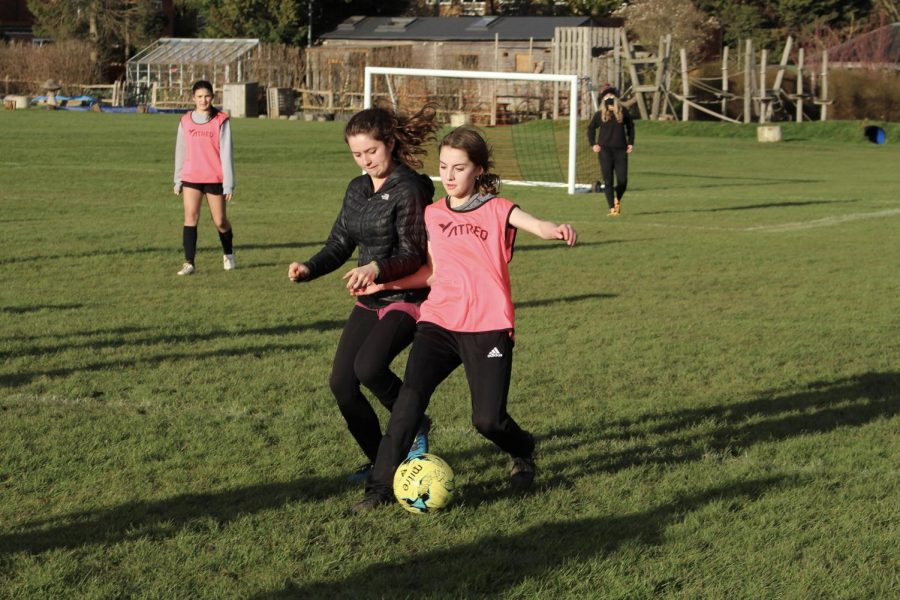 Amelia Moore ('24) runs to steal the ball from Faustina Tavassoli ('23) March 17. In Grade 9, Tavassoli played varsity soccer, helping the team to a second place finish at ISSTs.
