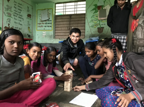Arhan Sarma ('22) plays games with school children from the Sonkheda Village in 2019. He said he made many Meaningful connections with the children he worked with.