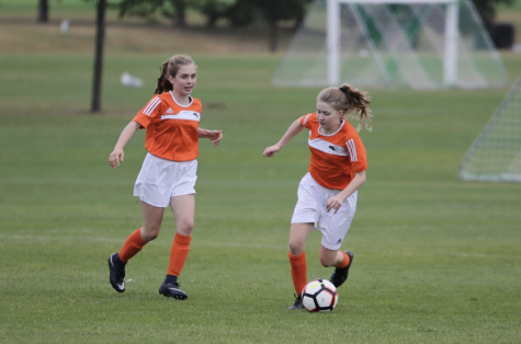 Casey Johnston ('23) dribbles down the field after receiving a pass from Kyle Kettler ('23) October 2020 at Regents Park. Both Johnston and Kettler played JV Soccer last season.