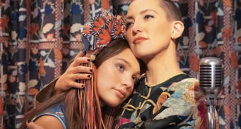 "Zu, played by Kade Hudson, comforts her autistic half-sister Music, played by Maddie Ziegler. Although Sia's ""Music"" was intended to raise awareness and shed a positive light on Autism Spectrum Disorder, the movie received conflicting reviews over its portrayal of the disability."