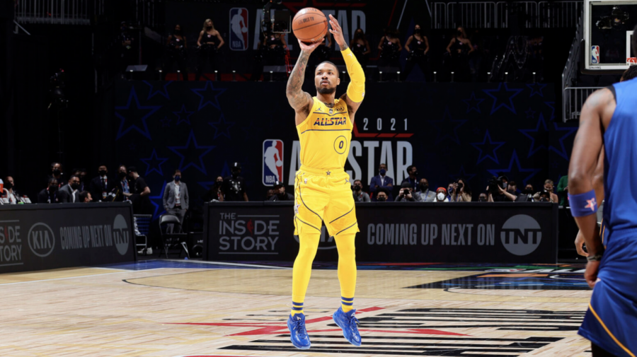 Portland Trail Blazers player Damian Lillard shoots a three-point shot at this year's all-star game. The all-star teams were drafted by captains LeBron James and Kevin Durant, with James' team winning the game 170-150 per Sporting News.