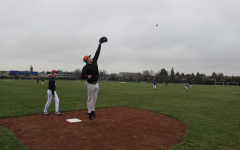 Malakai Spencer ('21) catches a baseball mid-air March 18. Spencer played on the boys varsity baseball team in Grades 9 and 10 as a pitcher and infielder.