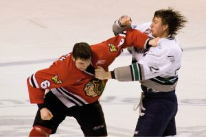 A fight in ice hockey in February 2009: Chicago Blackhawks player Brett Ponich vs. Seattle Thunderbirds Devon Leblanc. Appreciated for its entertainment value, fighting in ice hockey is also part of the tactics of the sport.