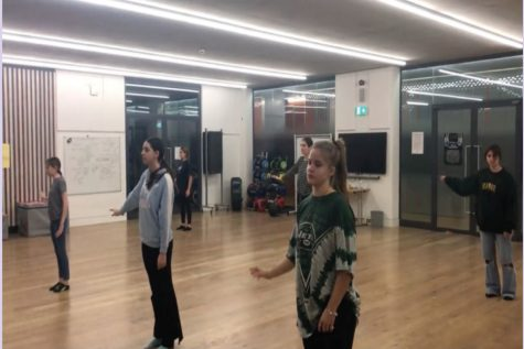Dance students rehearse their routine in December for a pre-recorded performance video. Students in PE, dance and fitness are not required to wear masks while exercising as long as social distancing and COVID protocols are followed.
