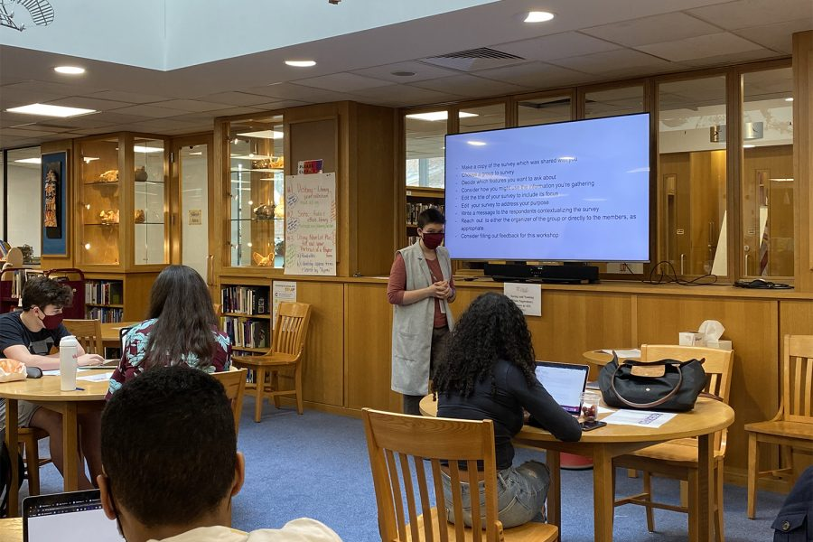 "Arabic Teacher Ruth McDonough leads the workshop ""Seeing and Naming White Supremacy at ASL."" After discussing aspects of the ASL community that are shaped by white norms, participants created surveys to gather data on white cultural standards."