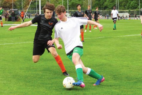 Max van Zyl ('21) attempts to steal the ball from an opponent during the varsity boys' game against Cobham May 26. Cobham defeated ASL 3-0 in ASL's last game of the season.