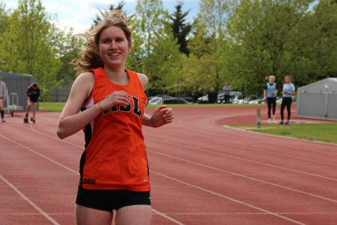 Annesley Potchatek ('24) smiles while warming up for the 100 meter race.