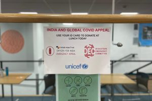 A poster encouraging students to donate to organizations supporting those suffering in India hangs in the Theater Foyer. Members of the Community Action Committee organized a fundraiser to help provide vaccines, medical supplies and treatment facilities for Indian relief.