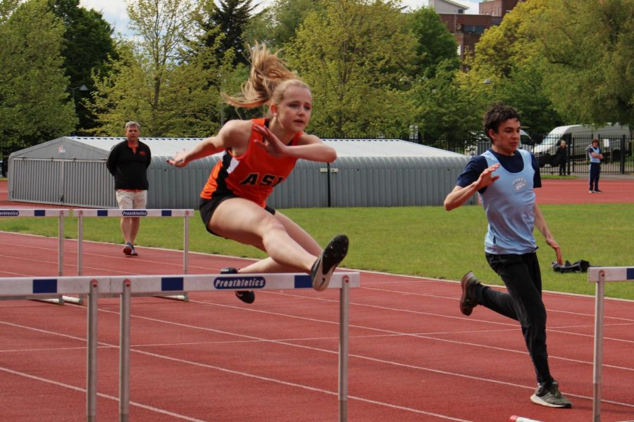 Abby Dichter ('23) jumps over hurdles May 19.