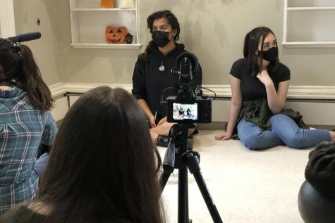 Ruby Read ('23) and Ellie Taylor ('23) act in a scene filmed at 47 Grove End Road May 8. Read and Taylor are both enrolled in the Advanced Acting: TV and Film class and collaborated with two other film classes to produce three-minute films for the annual High School Film Festival.