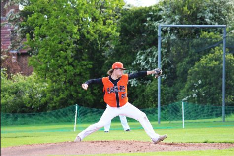 Nate Lewis ('23) throws a pitch at Canons Park against Lakenheath May 19.