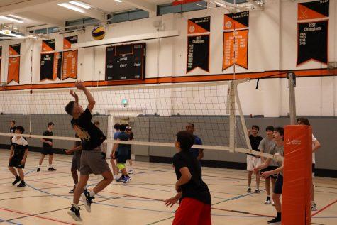 Brandon Likola ('23) jumps to spike the ball over the net in the Farmer Gym Sept. 1.