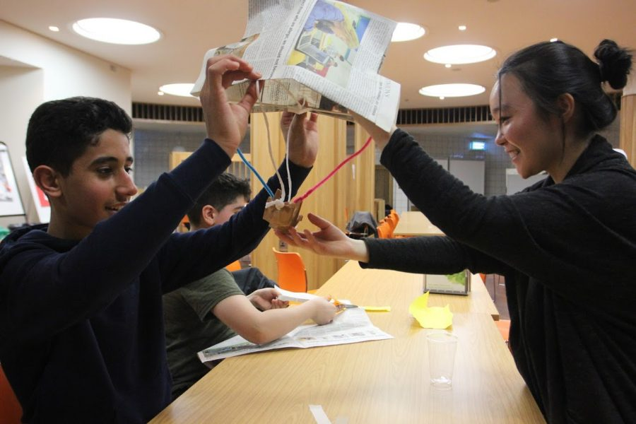 Marie Ogino ('20) helps local students explore their interests at the Shine community partnership, where ASL students can mentor other students on the ASL campus, in 2019.